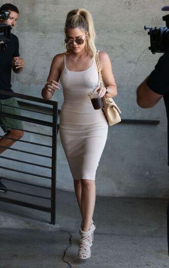 dress khloe kardashian sunglasses bag high heels hair accessory bracelets necklace shoes bodycon dress nude dress nude bag
