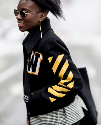 jacket tumblr nyfw 2017 fashion week 2017 fashion week streetstyle black jacket bomber jacket baseball jacket teddy jacket sunglasses earrings gold jewelry gold earrings jewels jewelry