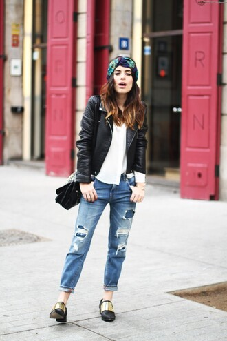 jeans black shoulder bag cuffed jeans blue jeans ripped jeans t-shirt white t-shirt shoes black shoes jacket leather jacket black jacket backpack black bag shoulder bag