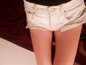 jeans,denim shorts,white jewels,white jeans,levi's shorts,ripped shorts,cross,blonde hair,orange shirt,levi's,white jeans high waisted american apparel,high waisted denim shorts,white denim,white high waist shorts,white denim shorts