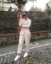 jumpsuit,beige,long sleeves,sneakers,white sneakers,sunglasses,earrings