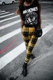 le happy,blogger,top,t-shirt,pants,bag,shoes,sunglasses,tank top,crossbody bag,plaid pants,boots