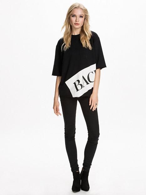 Sweat Banner T - Shirt - Back - Zwart - Tops - Kleding - Vrouw - Nelly.com