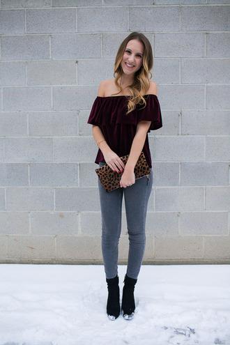 twenties girl style blogger top jeans shoes bag jewels off the shoulder top velvet top clutch animal print bag boots skinny jeans