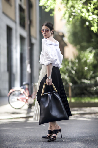 a portable package skirt bag sunglasses shirt