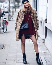 coat,tumblr,fur leopard print winter coat,fur coat,faux fur coat,leopard print,animal print,sweater,red sweater,burgundy,burgundy sweater,skirt,mini skirt,black skirt,leather skirt,black leather skirt,bag,black bag,tights,net tights,fishnet tights,black boots,beanie