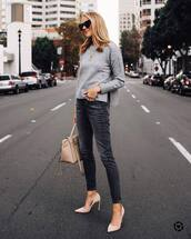 sweater,knitted sweater,crewneck,jeans,grey jeans,skinny jeans,pumps,high heel pumps,handbag,sunglasses,black sunglasses