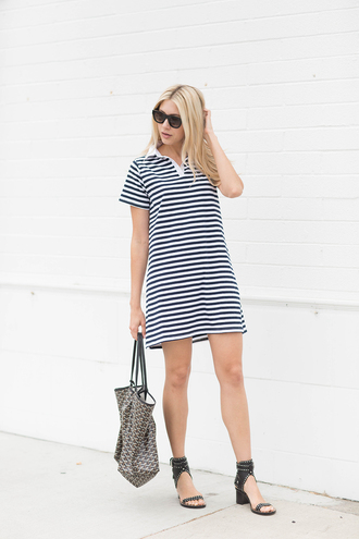 modern ensemble blogger dress shoes bag sunglasses stripes striped dress mini dress wedges black heels black and white t-shirt dress short sleeve dress black sunglasses mid heel sandals sandals black sandals handbag printed bag casual dress casual
