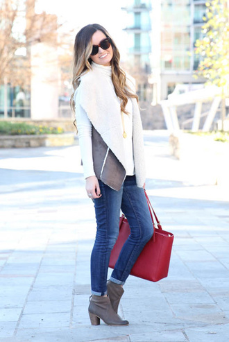 jacket shearling vest vest tumblr shearling bag tote bag red bag jeans denim blue jeans boots brown boots ankle boots mid heel boots sweater white sweater turtleneck turtleneck sweater sunglasses fall outfits white turtleneck top