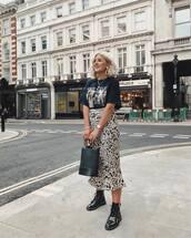 skirt,midi skirt,printed skirt,animal print,boots,vinyl,handbag,black t-shirt,earrings