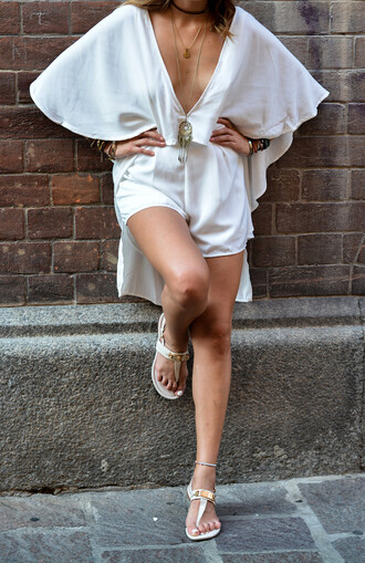 the art sartorialist blogger romper jumpsuit jewels sunglasses bag white romper white shorts white shoes sandals all white everything