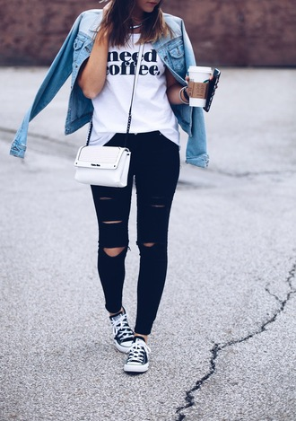 fashionably kay blogger sunglasses denim jacket white top quote on it white bag black jeans ripped jeans black sneakers