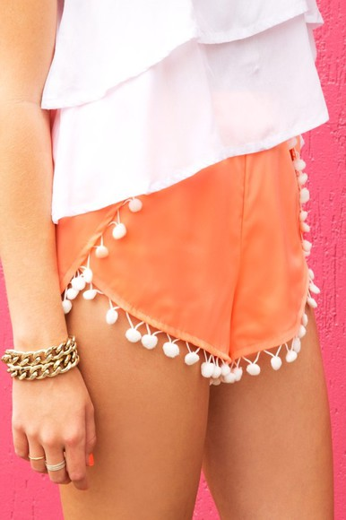 shorts orange shorts pom poms layered shirt