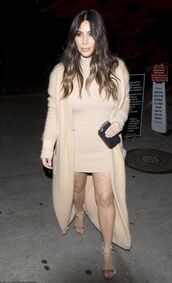shoes,sandals,kim kardashian,nude,nude dress,nude cardigan,cardigan,mini dress,bodycon dress,kardashians,velvet shoes,high heel sandals,sandal heels,nude sandals,party dress,party outfits,turtleneck dress,long cardigan,velvet sandals