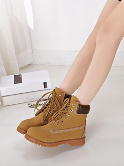 Yellow lace up ankle boots