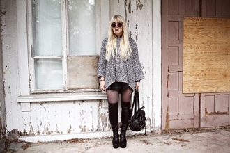 thelma malna blogger oversized sweater black boots tartan skirt