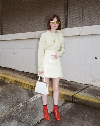 skirt mini skirt red boots sunglasses yellow yellow top sweater boots ankle boots