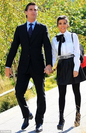 blouse,kourtney kardashian,bowtie,white shirt,black skirt,strappy sandals,mens suit,skirt,bag,shoes