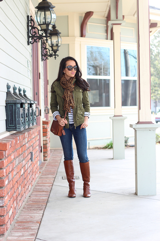 stylish petite blogger jacket shirt jeans shoes scarf sunglasses army green jacket top striped top long sleeves crossbody bag brown bag boots brown boots knee high boots blue jeans fall outfits pocket jacket