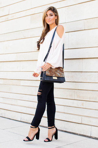 the darling detail - austin fashion blog blogger jeans shoes bag jewels dress white top long sleeves animal print shoulder bag black jeans ripped jeans sandals black sandals thick heel black ripped jeans sandal heels high heel sandals animal print bag cut out shoulder