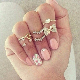 jewels rings ring gold sliver sparkle sparkles bling girly cute nice pretty cool jewelry heart bow knuckle ring rings set 18k gold bow ring heart ring gold rings nail polish bows pearls shiny star key help me find this midi finger ring