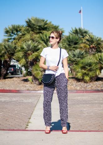 thefashionstatement blogger pants t-shirt bag shoes jewels sunglasses crossbody bag white t-shirt pumps red shoes