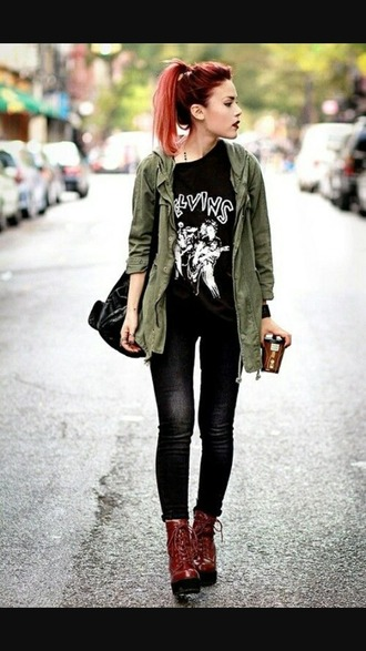 coat jacket army green jacket shoes red shoes black black jeans black top black t-shirt logo top patterned top black bag jeans black tee bag green jacket