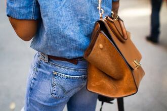 bag brown brown leather bag shirt blue jeans levi's