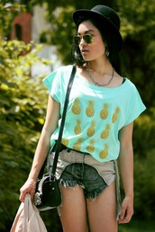 alessandra kamaile,t-shirt,pineapple print,denim shorts,aviator sunglasses,hat,summer outfits,clutch,blogger,necklace,beach,festival,hipster,boho chic,ripped shorts