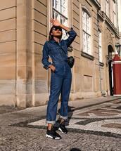 jumpsuit,cropped jumpsuit,denim,long sleeves,sneakers,crossbody bag,sunglasses