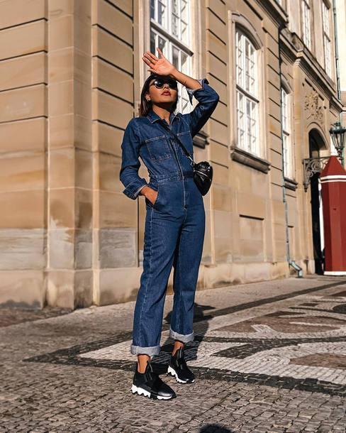 jumpsuit cropped jumpsuit denim long sleeves sneakers crossbody bag sunglasses