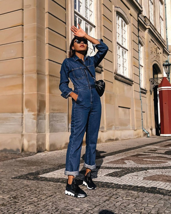 jumpsuit cropped jumpsuit denim long sleeves sneakers crossbody bag sunglasses