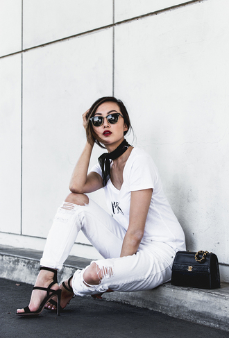 jeans minimalist black and white white jeans white ripped jeans ripped jeans bandana silk scarf sandal heels spring outfits spring classy chanel bag designer bag blogger white t-shirt