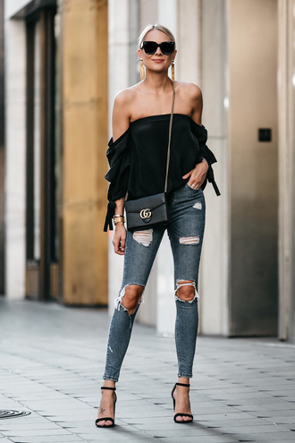 fashionjackson blogger top jeans shoes bag jewels sunglasses tumblr black top off the shoulder off the shoulder top denim blue jeans skinny jeans ripped jeans sandals sandal heels high heel sandals