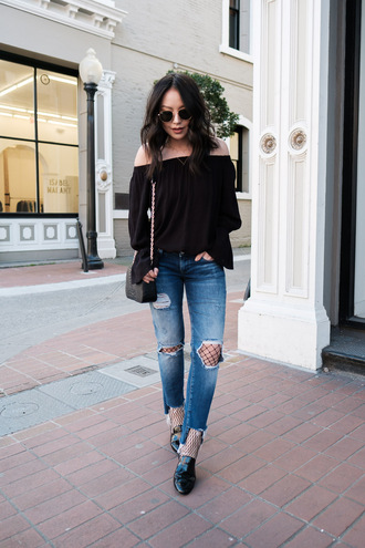 jeans off shoulder black shirt distressed denim jeans black shoes blogger fishnet tights sunglasses