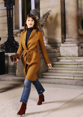 coat mustard coat top jeanne damas fashionista black top turtleneck jeans blue jeans boots brown boots bag brown bag