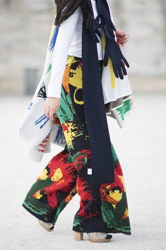 pants fashion week street style fashion week 2016 fashion week paris fashion week 2016 printed pants wide-leg pants top white top long sleeves scarf streetstyle