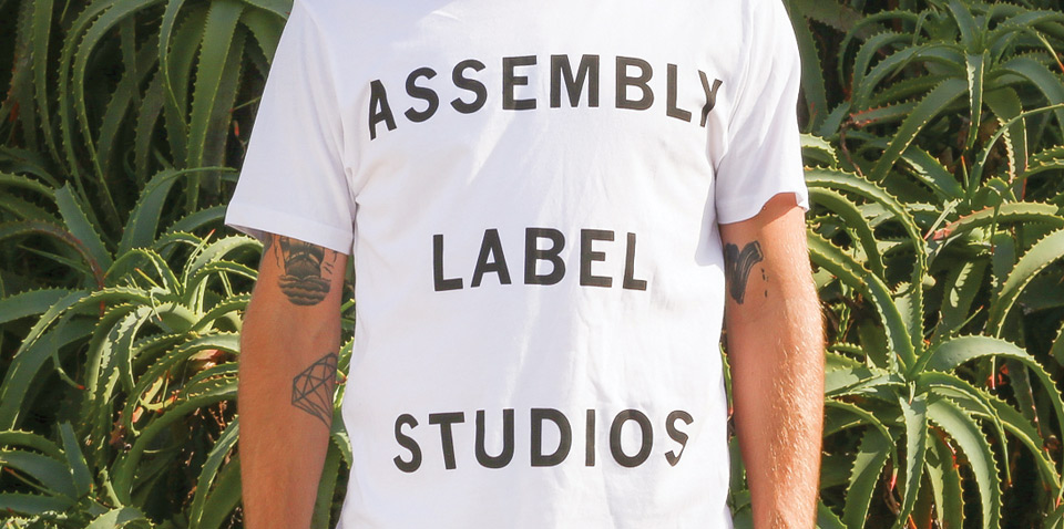 Assembly Label: Home: Fine Design & Well Made Clothing for Wholesome Living.