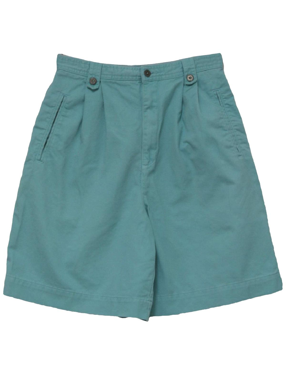 Womens teal blue thick cotton high waist wicked 90s shorts with button/zip front closure, deep pleated waistline, classic three pocket styling and wide legs.