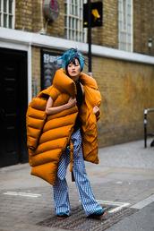 coat,fashion week street style,fashion week 2016,fashion week,london fashion week 2016,mustard,quilted,pants,tartan,plaid,printed pants,top,black top,blue hair,hairstyles,puffer jacket,oversized coat