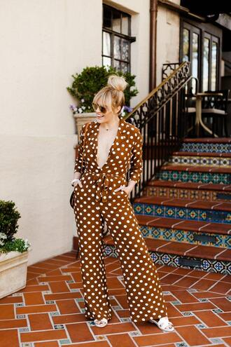 the courtney kerr blogger jumpsuit shoes jewels bag sunglasses polka dots polka dots jumpsuit spring outfits