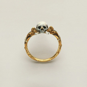 jewels,ring,skull,jewelery,jewelry,skeleton gold ring,white skull,skull ring,gold jewelry,gold