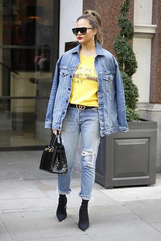 top t-shirt yellow chrissy teigen jeans denim jacket denim streetstyle london fashion week 2017