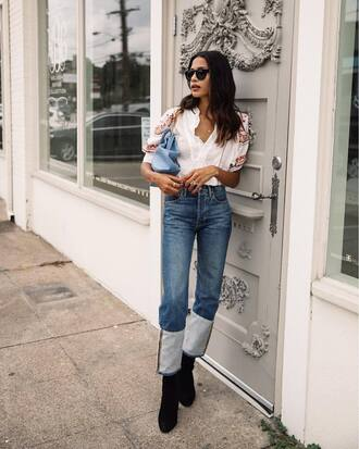 top short sleeve tumblr white top denim jeans blue jeans cuffed jeans boots black boots bag sunglasses shoes