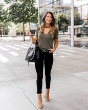 bag,studded bag,handbag,skinny jeans,sandals,western belt,blouse,cut-out,earrings