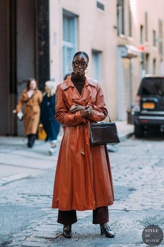coat leather coat long coat orange coat orange top black bag bag shoes sunglasses streetstyle