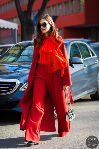 shirt all red outfit red shirt bow shirt bow pants red pants wide-leg pants coat red coat long coat bag black and white shoes black shoes sunglasses black sunglasses streetstyle