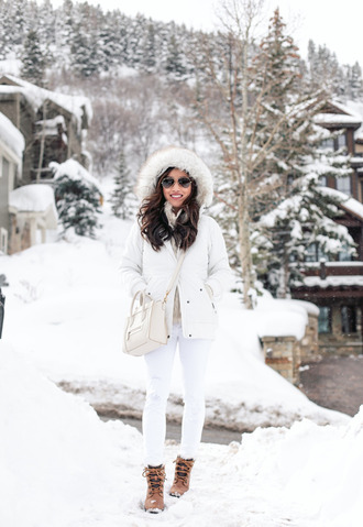 extra petite blogger jacket sweater jeans shoes hat sunglasses bag winter outfits nude bag boots white coat tumblr white fur vest faux fur vest fur vest grey beanie beanie pom pom beanie white sweater denim white jeans white bag all white everything