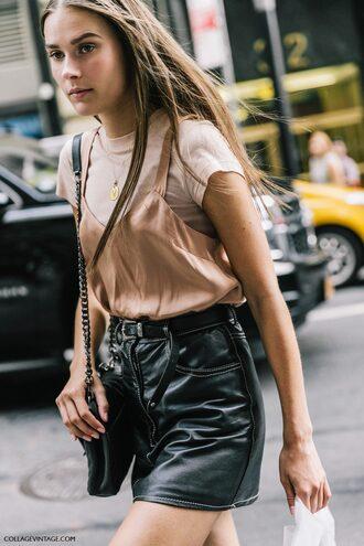 skirt fashion week street style fashion week 2016 fashion week ny fashion week 2016 leather skirt black skirt top nude top t-shirt nude t-shirt bag black bag tumblr