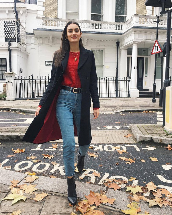 jeans blue jeans high heels boots black coat red sweater black belt gold jewelry